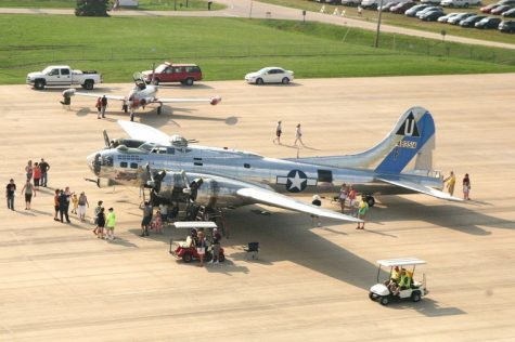 Visitors at the DeKalb Cornfest inspect a B-17 aircraft brought to the fest by the Arizona branch of the Commemorative Air Force Saturday Aug. 21 at the DeKalb Municipal Airport.