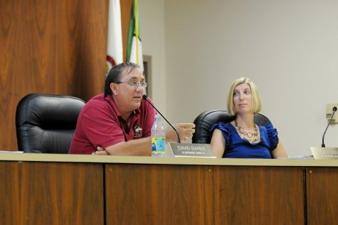 Sixth Ward Alderman David Baker discusses the presentation by the police and fire pension boards as 7th Ward Alderman Lisa Kammes listens during Monday's DeKalb City Council meeting.