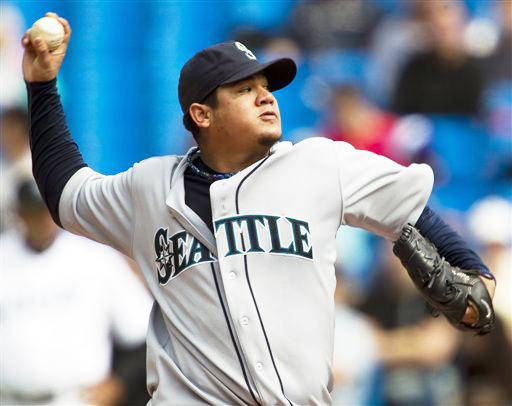 Seattle Mariners starting pitcher Felix Hernandez throws during the fourth inning of a baseball game against the Toronto Blue Jays in Toronto on Thursday, Sept. 23.