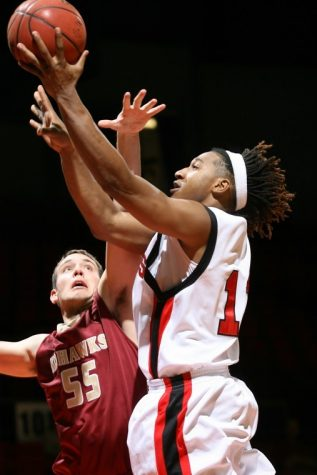 Freshman Nate Rucker (right) goes up to score in Saturday's exhibition victory.