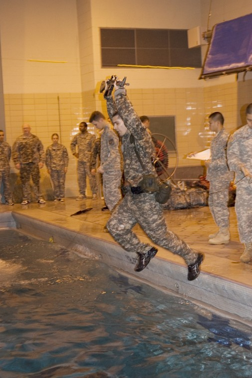 Daniel Martinez, Freshman computer science major, leaps into the Gabel Hall pool as part of the ROTC water combat training.