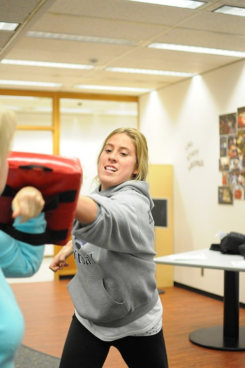 Junior nursing major Alyssa Kroeschen participates in the women's self defense seminar. The class taught women how to prevent dangerous situations and how to react if being attacked.