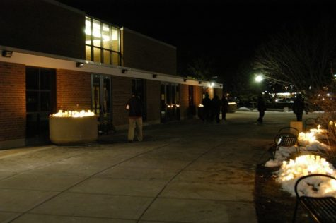 NIU students leave flowers and candles at Cole Hall after the 2009 candlelight vigil honoring the victims of the Feb. 14 shootings.