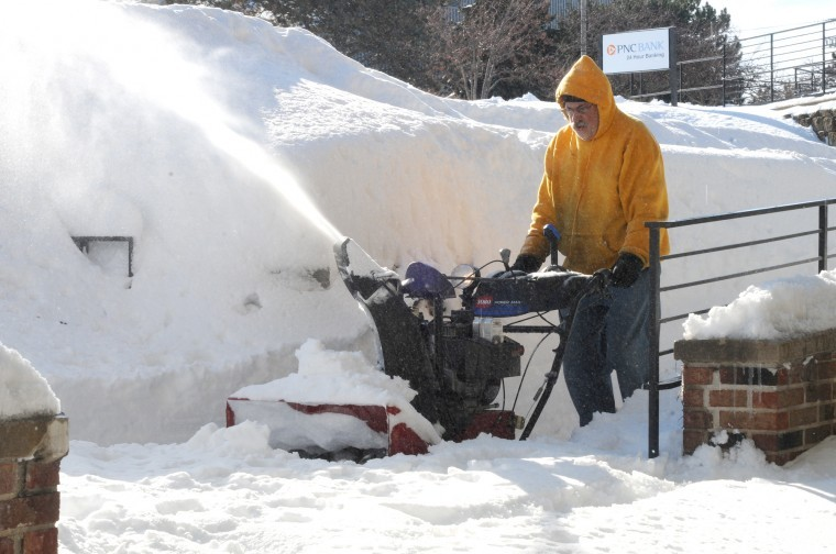Jerry+Burnes+%7C+Northern+Star%0AA+snow+plower+removes+snow+from+the+sidewalks+below+the+Village+Commons+Bookstore+on+Lucinda+Avenue.+The+blizzard+that+hit+DeKalb+Tuesday+into+Wednesday+dropped+18.7+inches+of+snow+on+the+ground.+