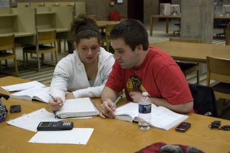 Sophomore business administration majors Michelle DiVita (left) and Nick Nudo (right) study at Founders Memorial Library Wednesday night.