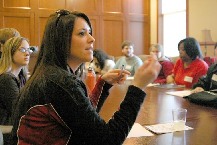 Nicole Gault   Northern Star  Nicole Kelly, senior public health major, asks questions during Destination Graduation's first break out session,