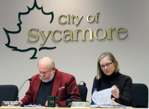 Sycamore Mayor Ken Mundy and City Clerk Candy Smith review the FY2012 budget Wednesday night