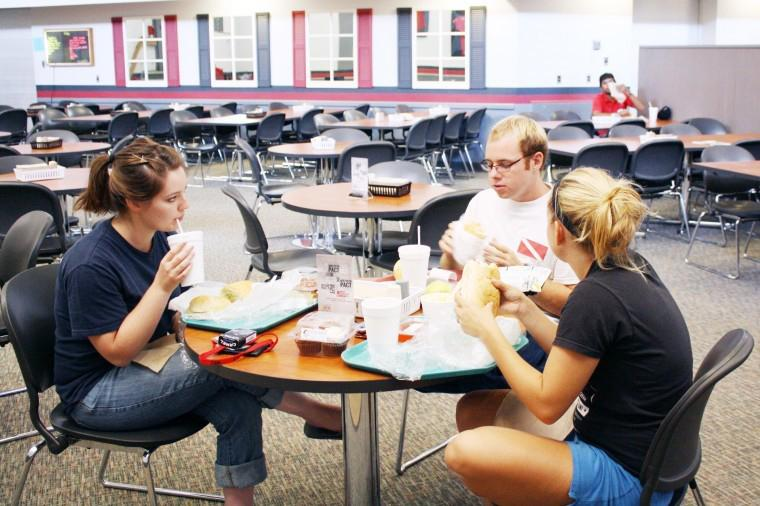 Alicia Artner (left) and Brian Walsh (middle), both junior English majors, and Alexis Paull (right), sophomore psychology major, dine at the Dog Pound Deli in Douglas Hall.