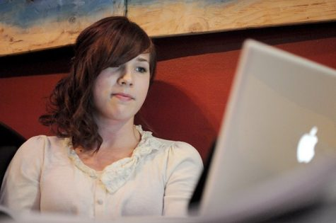 Laura Ewert, anthropology graduate student, works on class work at the House Cafe Wednesday night