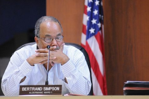 First ward alderman Bertrand Simpson listens to debate about outsourcing the city attorney and assistant city attorney's position Monday night at the regular meeting of the DeKalb City Council.