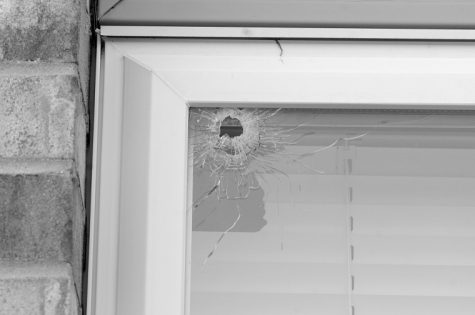 Jerry Burnes | Northern Star A window at 1009 Aspen Dr. is broken after gunshots were fired at the building Tuesday night. Neighbors confirmed Wednesday that the window was at Apartment 3, the intended target of the gunshots. A bullet penetrated the glass and struck NIU line backer Devon Butler.