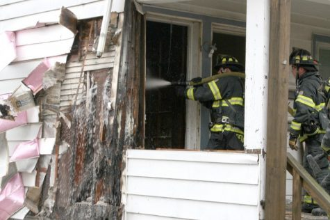 Firefighters battle an electrical fire at 414 Prospect St. in DeKalb Tuesday morning.