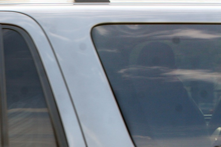 Jack McCullough sits in the back of a Ford Expedition as he is transported from Seattle to the DeKalb County Jail.