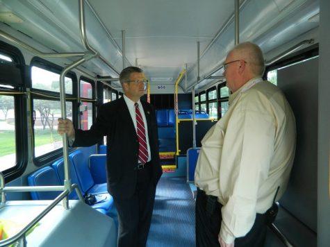 Congressman Randy Hultgren speaks with Al Davis, General Manager of Huskie Bus regarding the Huskie Bus system.