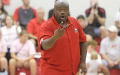 Volleyball coach Ray Gooden works with the team during a match last season.