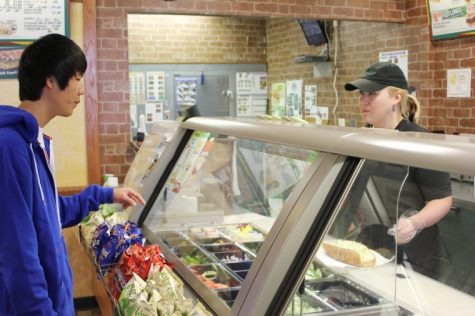 Kevin Choi, freshman electrical engineering major purchases a sub from Subway.