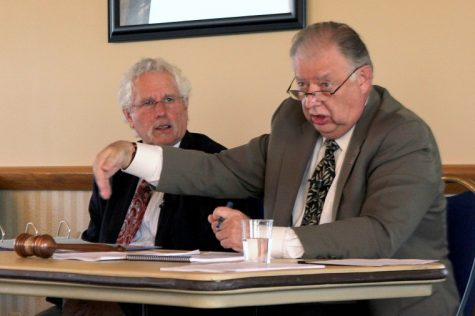 Gavin Weaver | Northern Star NIU President John Peters (right) and executive secretary Alan Rosenbaum (left) discuss the NIU budget Wednesday at University Council in the Sky Room of the Holmes Student Center.