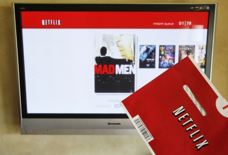 In this Oct. 1 photo, a Netflix DVD envelope and Netflix on-screen television menu are shown in Surfside, Fla. Netflix's CEO says it's abandoning its widely panned decision to separate its DVD-by-mail and Internet streaming accounts.