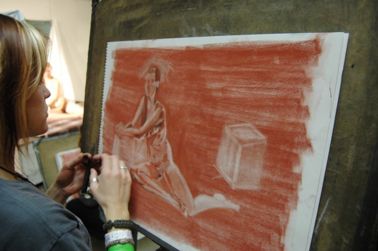 Sam Dundeck, sophomore visual communication major, draws a live model in her life drawing class Thursday morning.