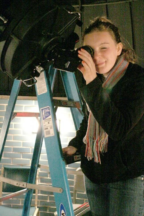 Courtney Vadnais, freshman translation and business spanish major, looks through the Davis Hall Oberservatory's telescope to see the stars in November 2011.