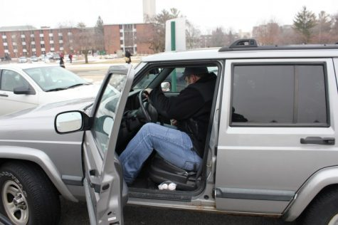 Pete Fraser, senior communications major and commuter student, gets into his Jeep in the parking lot by DuSable to head home Thursday afternoon.