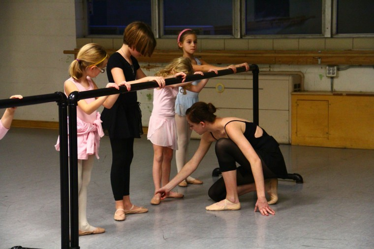 Jessica Greenen, junior elementary education major, teaches ballet to a community dance class in Gabel Hall Wednesday.