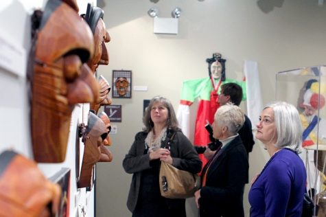 Marian Gebo (right), Pamela Brown (middle) and Barbara Fash (left) look at a collection of Korean masks in the Anthropology Museum Sunday afternoon during the grand opening of Cole Hall.