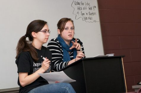 Northern Star Heather Olson (left), and Brittney Ginter, members of Colleges Against Cancer, lead the club's meeting Tuesday night.