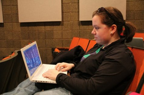 Senior marketing major Marissa Jambrone, uses her laptop computer before class in the Jack Arends Visual Arts Building Monday afternoon.