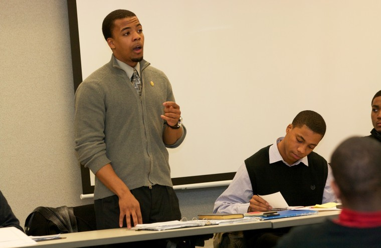 Thaddaeus Carr, Black Male Initiative president, speaks about group activities, such as study tables, at the organization's meeting Jan. 30.