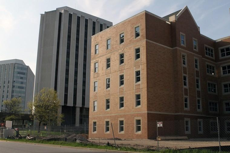 The new residence hall, overlooked by Grant North, nears completion.