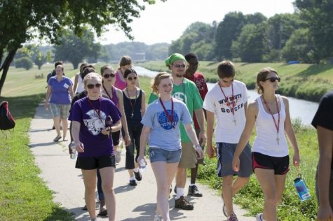 A group of high school students participating in the College of Liberal Arts and Sciences External Programming Environmental-Science Camp walk along the Kishwaukee River last summer.