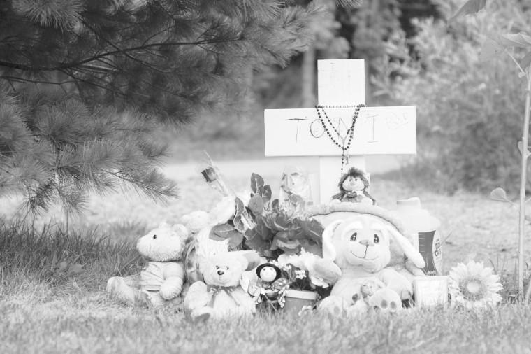 James McCarter   Northern Star A white cross and items gathered by loved ones of Toni Keller serve as a memorial for the slain Huskie. Family and friends of Keller hope to one day raise enough money to purchase Keller a true memorial.
