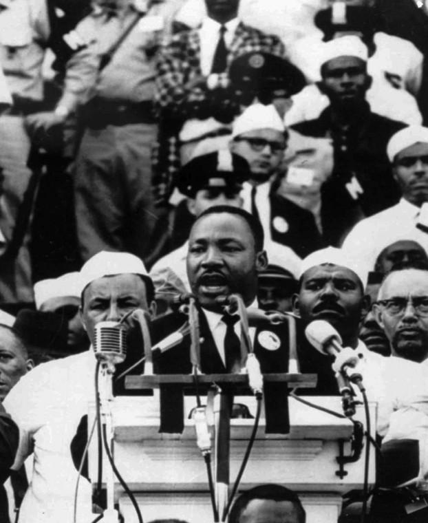 FILE- In this Aug. 28, 1963 file photo, Dr. Martin Luther King Jr., head of the Southern Christian Leadership Conference, addresses marchers during his Have a Dream speech at the Lincoln Memorial in Washington.