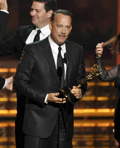 Tom Hanks accepts the award for outstanding miniseries or movie for 'Game Change' at the 64th Primetime Emmy Awards at the Nokia Theatre on Sunday in Los Angeles.