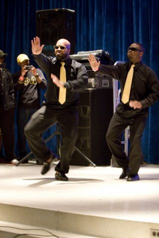 Brandon Hunter and Alandis Phillips of Alpha Phi Alpha fraternity Inc. strolling at the stroll competition in the Carl Sandburg Auditorium hosted by the women of Sigma Gamma Rho sorority Inc. The winners of the stroll competition were the women of Zeta Phi Beta Sorority Inc. and the men of Alpha Phi Alpha Fraternity Inc.
