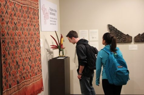 Sophomore Finance major, Zachary Zehme and Sophomore Elementary Education major, Gabriela Godinez view a piece at the Anthropology Museum's new Southeast Asia Exhibit in Cole Hall Tuesday afternoon.
