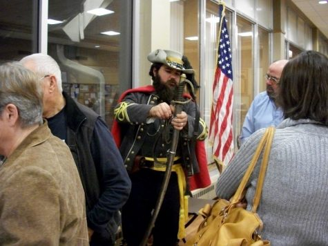 Reenactor Andy Hare portrays General J.E.B. Stuart describing his weapons to guests of