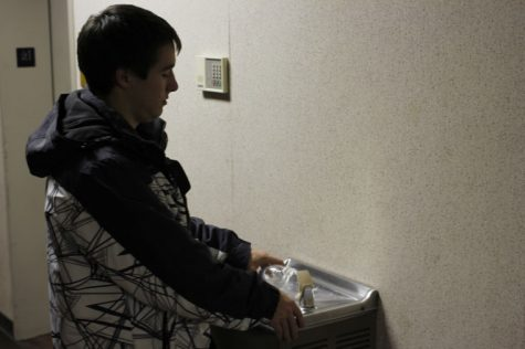 Will Wilson, senior pre-physical therapy major, refills his water bottle from a water fountain in February 2013.