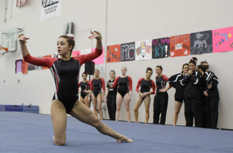 Sophomore+Amanda+Stepp+strikes+a+pose+during+her+floor+routine+at+the+meet+against+Eastern+Michigan+University+on+March+1.%0A