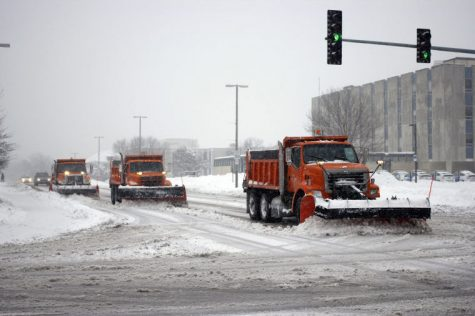 DeKalb snowplows plow Lucinda Ave. during the heavy snowfall on Monday, which caused Northern Illinois University to cancel all classes after 12:30pm.