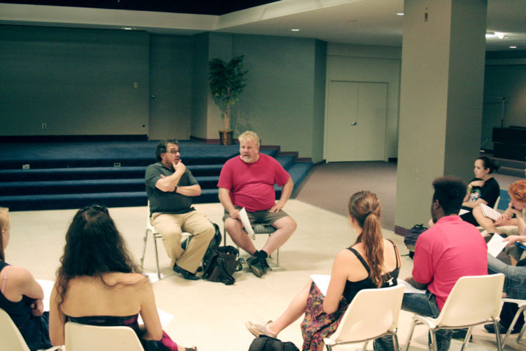 Acting head of B.F.A. Performance Stanton Davis (right in red) and co-teacher, director at the School of Theatre and Dance Alexander Gelman, discuss what's in store for the semester to the students of their Verse Drama for Shakespeare class.
