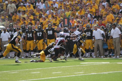 Junior wide out TommyLee Lewis about to be tackled by a Hawkeye defender late August at Kinnick Stadium. NIU will face the Vandals in their second match of the season on Saturday.