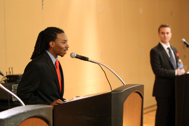 """Student Association presidential candidates Randiss Hopkins (left) and Joe Frascello (right) answer questions during a debate Wednesday night in the Holmes Student Center. Hopkins said NIU should use alumni to recruit prospective students, and Frascello said NIU should make improvements to become a """"fun campus."""""""