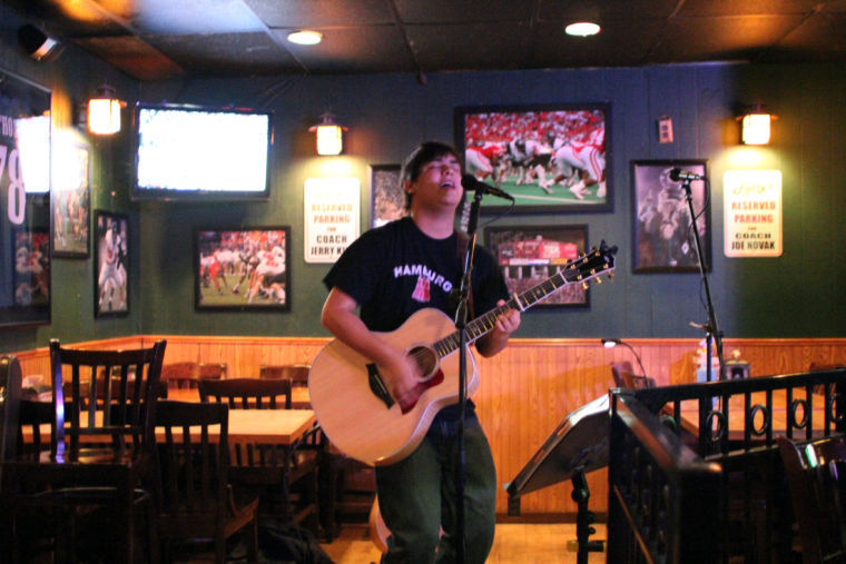 Luke Underhill, Yorkville High School senior and co-host of open mic night, sings and plays acoustic guitar Monday at Fatty's Pub, 1312 W. Lincoln Highway.