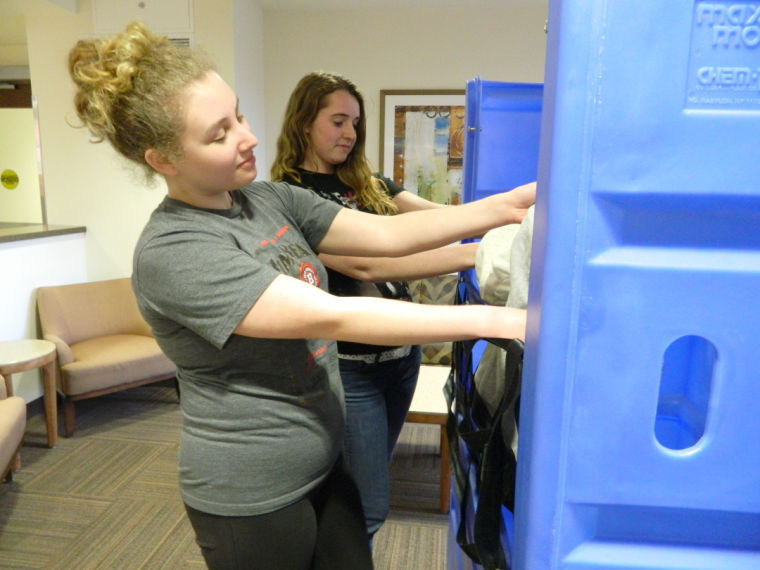 Kathryn Voight (left), freshman history and German major, and freshman nursing major Alex Filippini donate to Goodwill Tuesday in the New Residence Hall Commons. The NIU Give and Go: Move Out 2014 donation drive is held to encourage students to donate unwanted items before summer vacation.