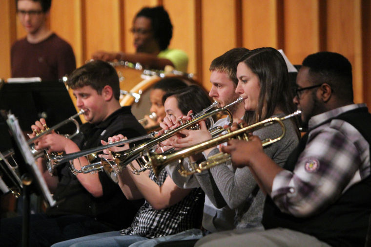 Musicians in the Wind Ensemble rehearse Tuesday for their spring performance. The concert features songs by Mozart and African composer O'Neal Douglas.
