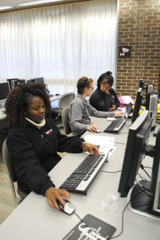 Christianah Olojede, junior rehabilitation service major; Megan Taylor, junior rehab counseling major; and Nicoya Parer, senior public health major, work on a group presentation for their counseling class Thursday in the computer lab of Founders Memorial Library.