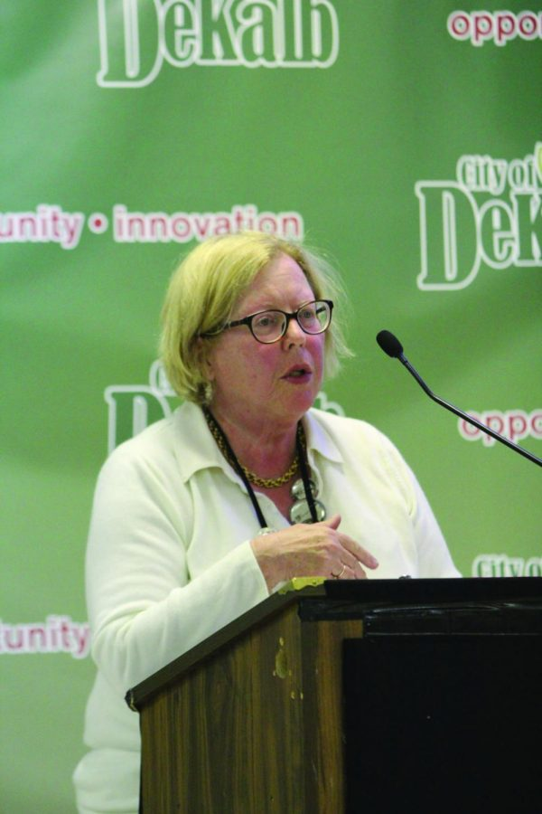 DeKalb Library Director Dee Coover updates City Council members on the status of the library's 2014 fiscal year Monday at the council meeting in the DeKalb Municipal Building, 200 S. Fourth St. Coover spoke about DeKalb's Big Read Month in October and she told council members the groundbreaking ceremony for the DeKalb Library expansion was a success.