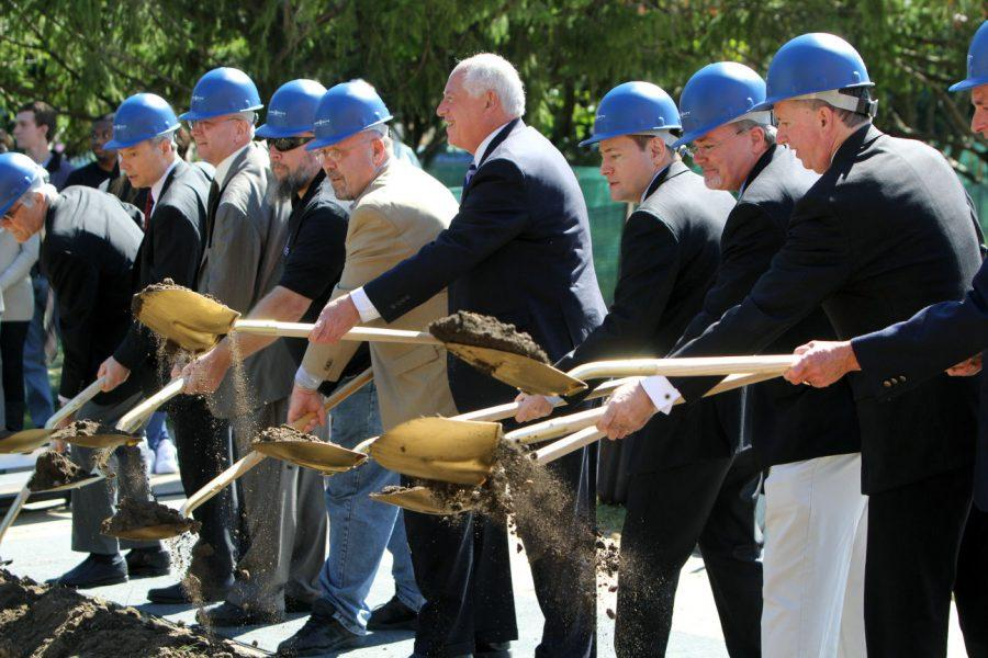 Gov. Pat Quinn (without hard hat), flanked by DeKalb Mayor John Rey on his left and John Butler, Board of Trustees chair, on his right, shovels dirt during the Stevens Building groundbreaking Monday. The building was demolished in the summer. Its 109,000-square-foot replacement will feature a 330-seat lecture hall and Black Box Theatre.
